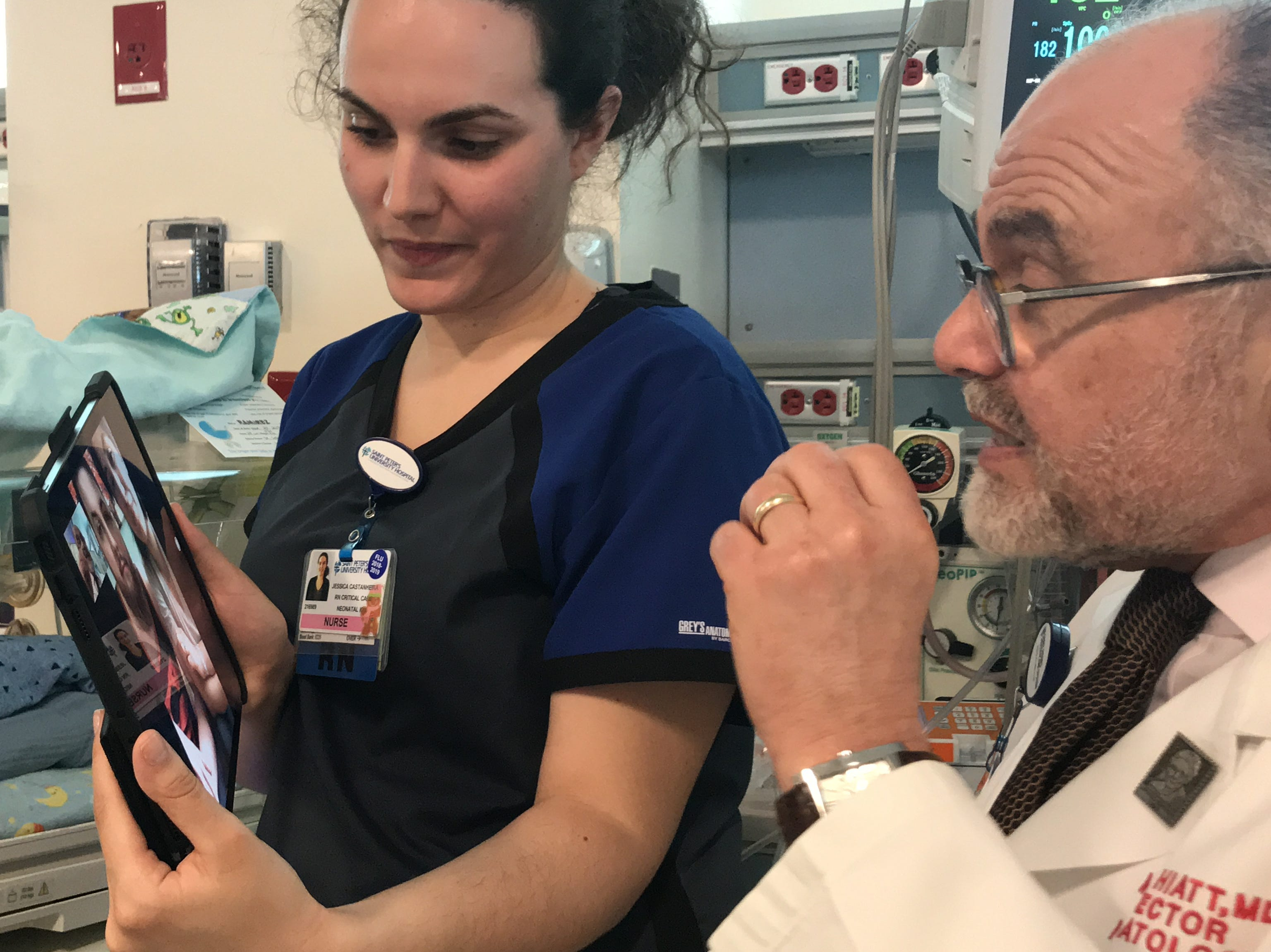 Dr. Mark Hiatt, chief of Neonatology at The Children's Hospital at Saint Peter's University Hospital in New Brunswick, and Neonatal Critical Care Nurse Jessica Castanheira, here with newborn Joseph Nardone Jr. of Rahway, demonstrate the recently launched daily FaceTime program in the Neonatal Intensive Care Unit (NICU). The first-of-its-kind in the state, the program delivers a liveaudio and visual feed to parents whose infants need specialized long-term care.