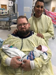 Angie and Michael Kelman of Hillsborough, here with their twin girls Ava and Amelia, were among the first to use the new Neonatal Intensive Care Unit (NICU) FaceTime program at The Children's Hospital at Saint Peter's University Hospital in New Brunswick. The first-of-its-kind in the state, the FaceTime program delivers a liveaudio and visual feed to parents whose infants need specialized long-term care.
