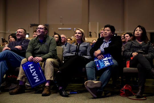 People in the audience listen as Andrew Yang, entrepreneur and 2020 caucus candidate, gives a speech and answers questions during a town hall on Sunday, April 28, 2019, at Franklin Junior High in Des Moines.