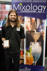 Ames Mixologist Ryan Jeffrey from Arcadia Cafe was named this year's champion at the Iowa Restaurant Association's State Mixology Championships held April 25th at Smash Park in West Des Moines.