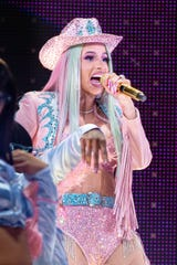 Rapper Cardi B performs at RodeoHouston on March 1. The rodeo said that the rapper set an all-time attendance record of 75,580 people.