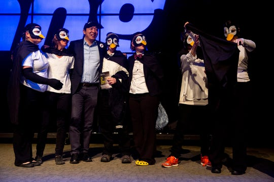 Andrew Yang, entrepreneur and 2020 caucus candidate, poses for a photo with a group of Iowans dressed as penguins after a town hall event on Sunday, April 28, 2019, at Franklin Junior High in Des Moines. The penguins asked Yang about his stance on climate change.