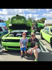 James Loyd Overstreet, a registered nurse from Shreveport, La., is pictured with Tyler Davis (left) at a car show in Bossier City, La. in 2018.