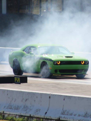 "James Loyd Overstreet of Shreveport, La., driving his 2015 Hellcat Challenger ""in its natural habitat"" at Thunder Road Raceway in Gilliam, Iowa in October 2017."