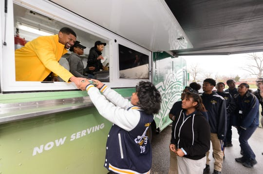 Wingstop Charities and Jalen Rose celebrate the academic achievements of Jalen Rose Leadership Academy students who achieved a GPA of 3.0 or higher last semester on Monday in Detroit.