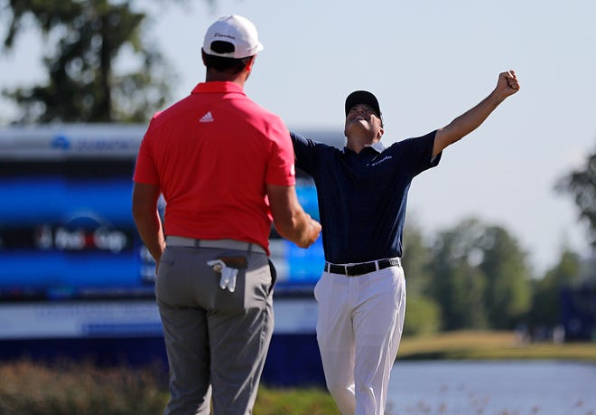 Ryan Palmer, right, celebrates with teammate Jon Rahm as they win the  Zurich Classic on Sunday.