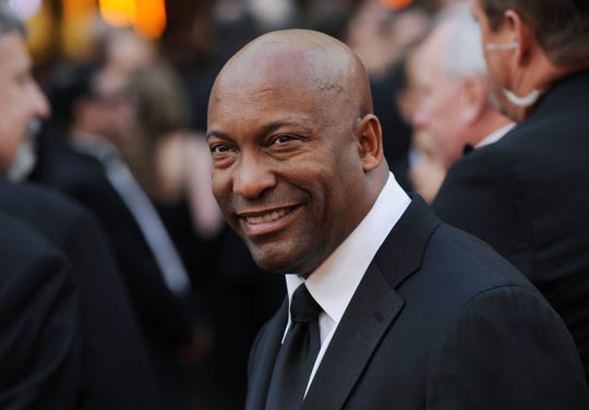 In this Feb. 24, 2008 file photo, director John Singleton arrives at the 80th Academy Awards in Los Angeles.