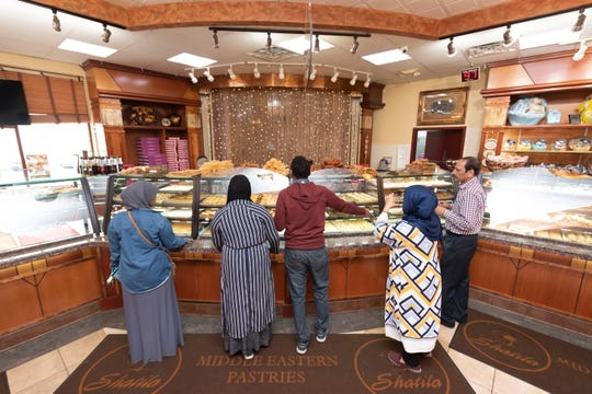 Customers line up to order pastries at the Shatila Bakery in Dearborn.