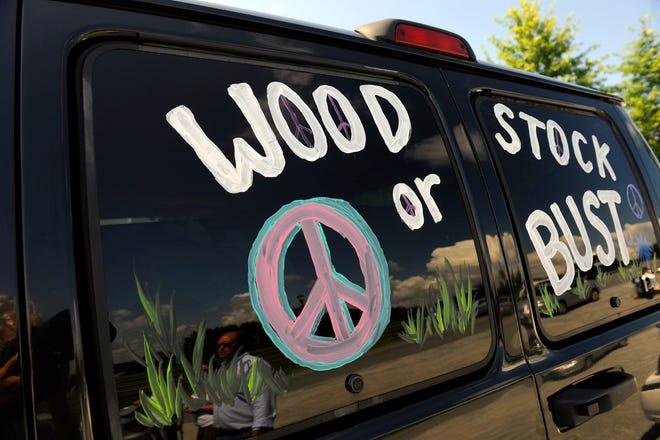 "A van decorated with ""Woodstock or Bust"" at the original Woodstock Festival site in Bethel, N.Y."