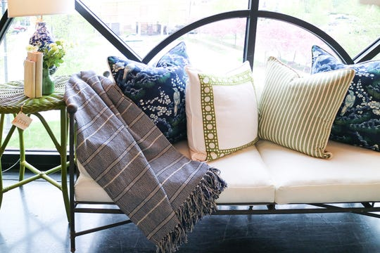 When artfully draped, a throw can be an elegant visual enhancement to any chair, sofa, bed or patio set. (Handout/TNS)