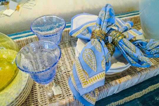 Cloth napkins in fun and funky patterns are a great way to dress up traditional table settings and give them a modern flair.