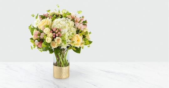A floral bouquet in a pretty vase leaves the recipient with a lovely keepsake.