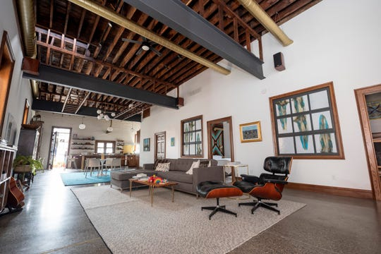 What was once the second floor living quarters of a 1908 Detroit firehouse is now the home of Detroit restaurant owner Phil Cooley, his wife Kate Bordine and their two kids, Josephine and Edmund.