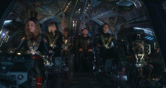 """Brie Larson, Scarlett Johansson, Don Cheadle, Chris Hemsworth, Chris Evans and Rocket (voiced by Bradley Cooper) in """"Avengers: Endgame."""""""