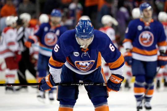 Islanders defenseman Ryan Pulock skates off the ice after the Hurricanes won Game 2 on Sunday.