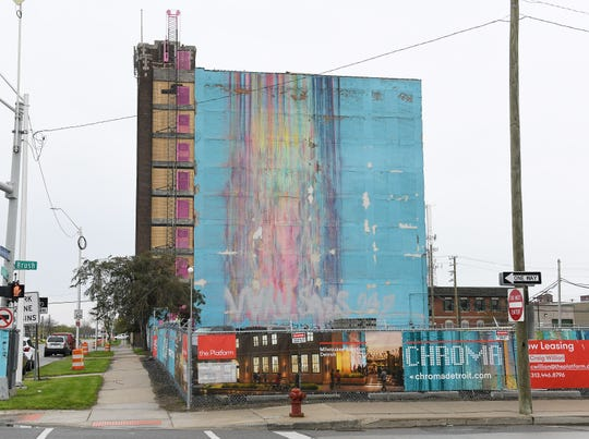 """Katherine Craig's colorful """"The Illuminated Mural"""" will remain in place on the building being developed by The Platform LLC at 2937 East Grand Boulevard in Detroit.   The first two floors will be rebranded as Chroma, a public market area."""