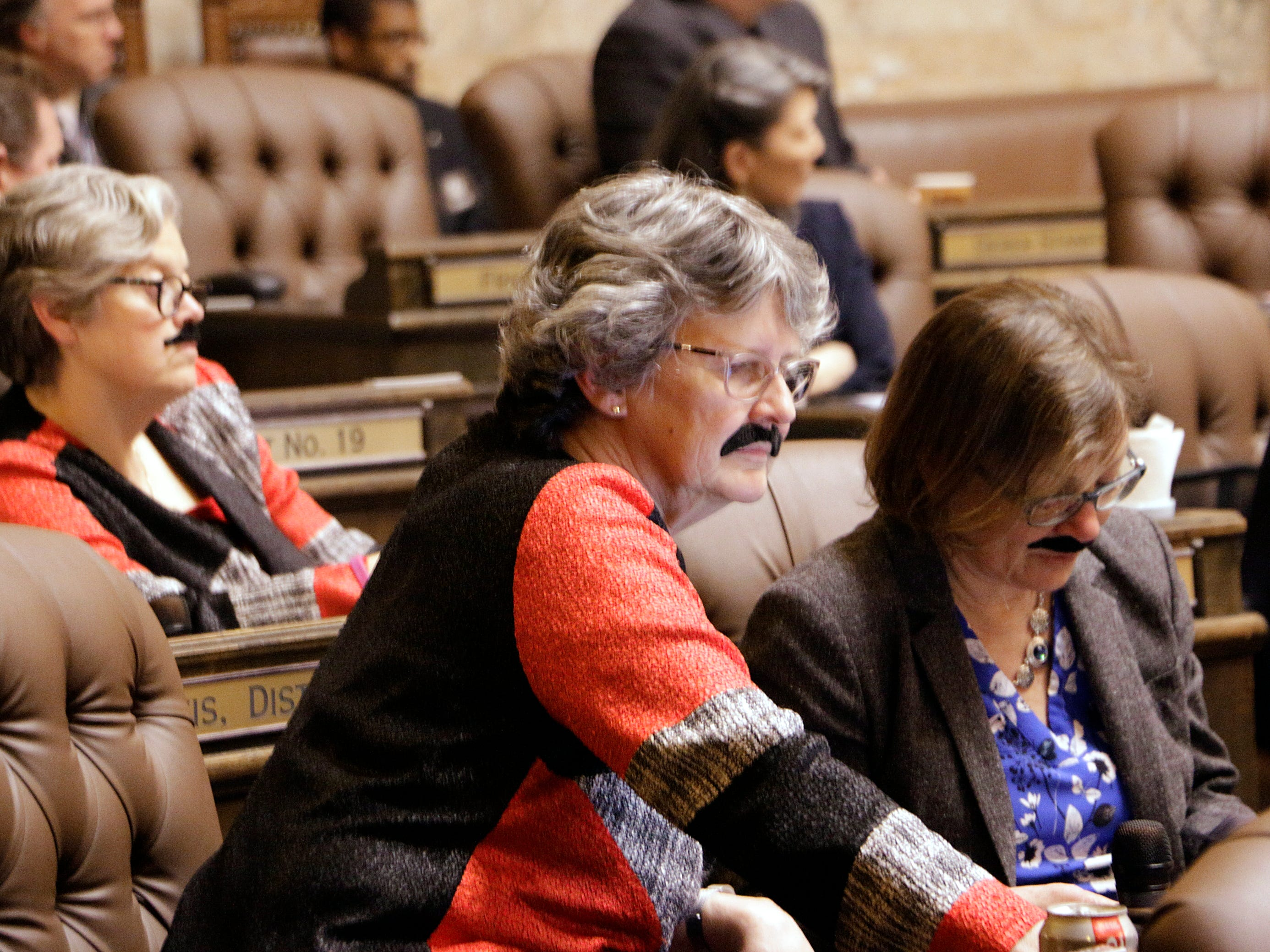 In Olympia, Washington, members of the state House wear fake moustaches to honor Speaker of the House Frank Chopp, who is stepping down from his leadership role after the legislative session ends. He is the state's longest serving speaker.