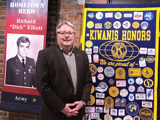 Elmira Kiwanis Club President Mike Wayne stands in front of a few of the items on display in a Kiwanis exhibit at the Chemung Valley History Museum.