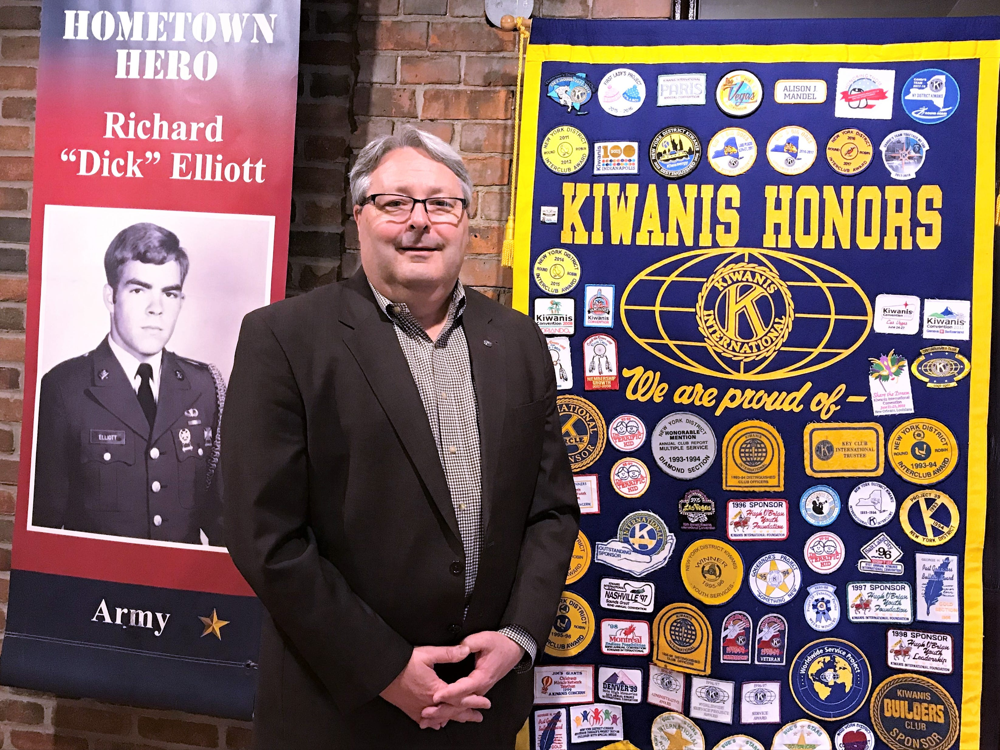 Elmira Kiwanis Club President Mike Wayne shows off a few of the items on display in a Kiwanis exhibit at the Chemung Valley History Museum.