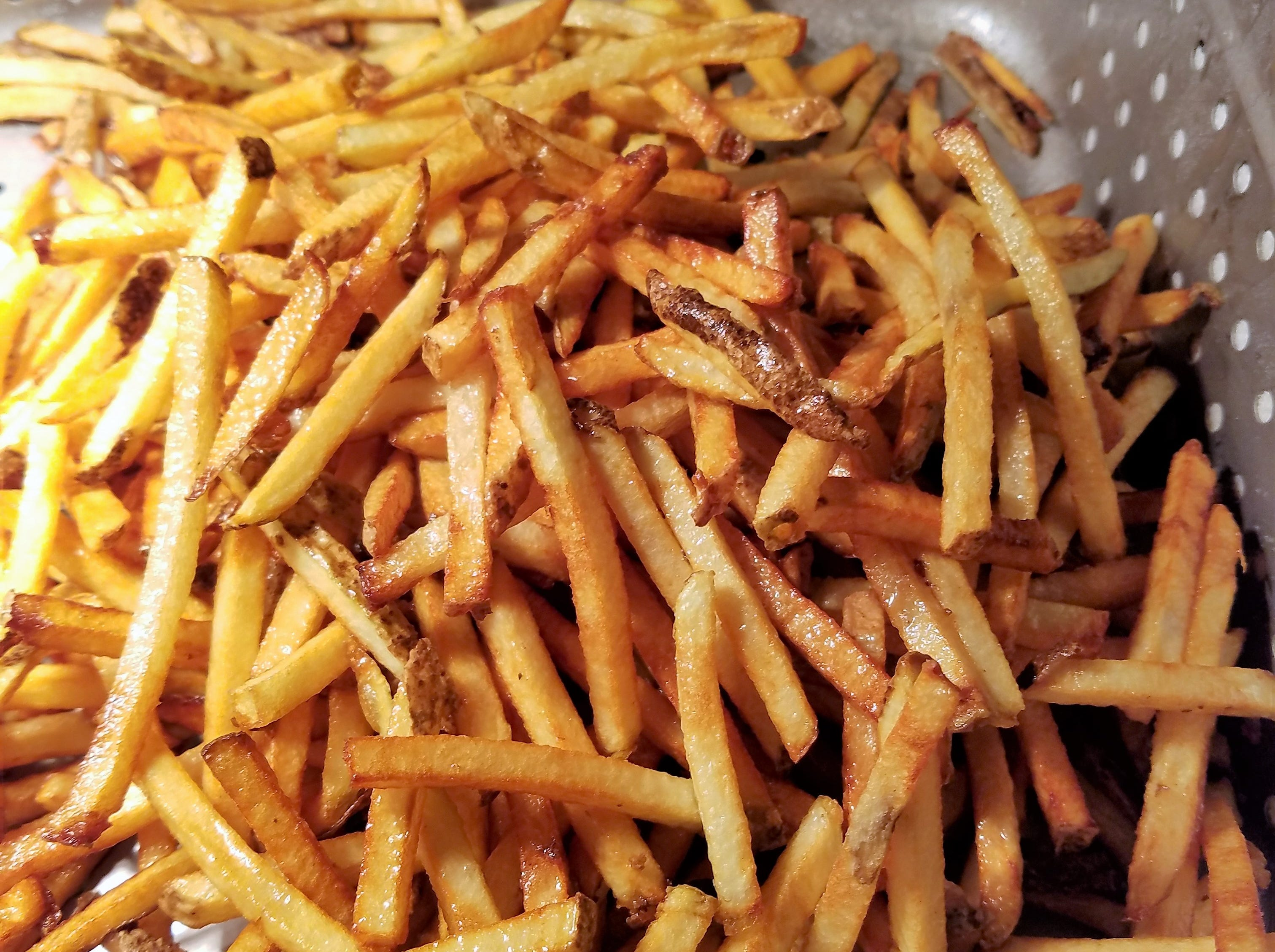 Crisp, twice-fried, fresh cut fries at Cool Cat's Me So Hangry Grill.
