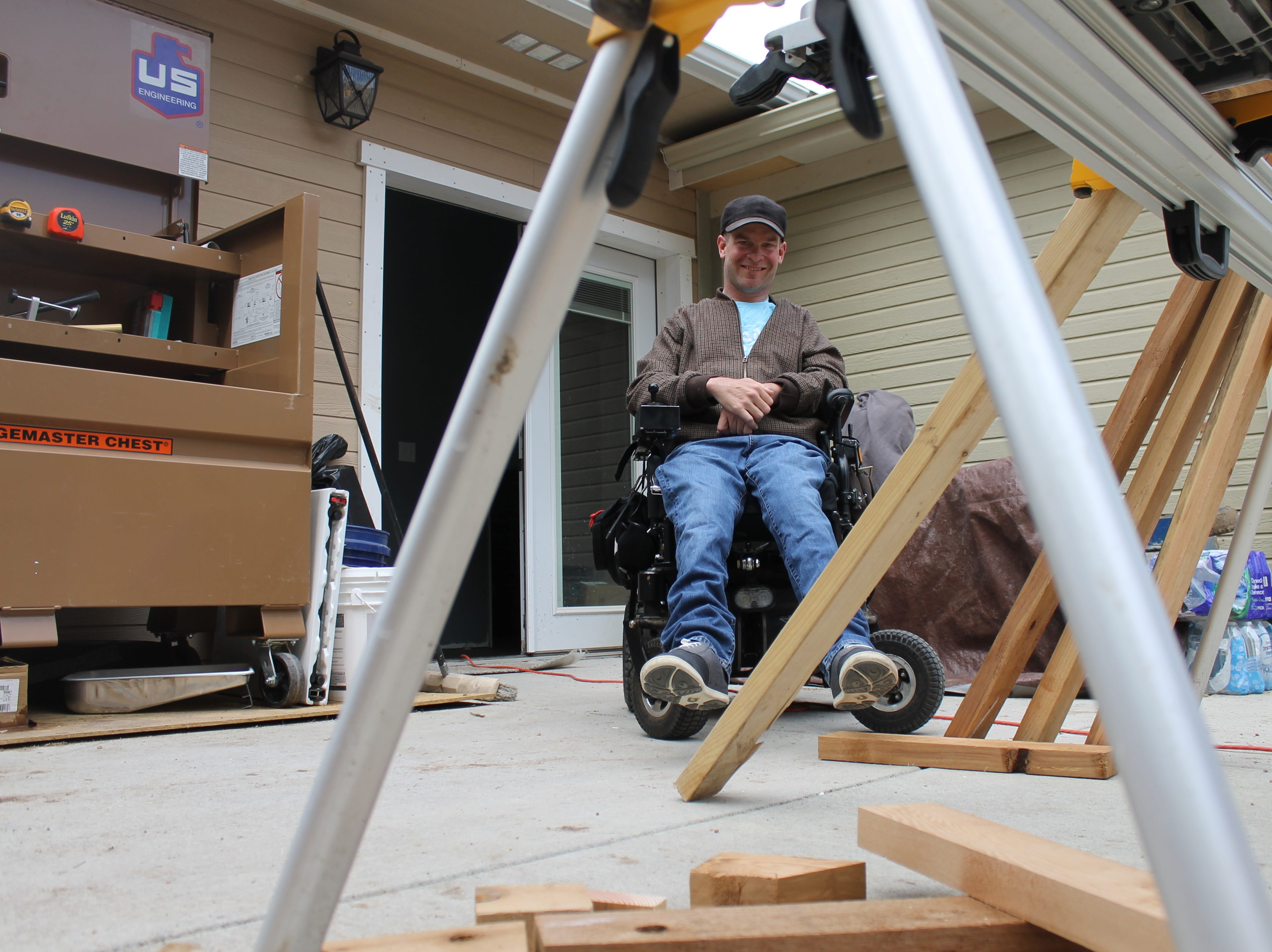 Terry Schlicting sits outside on his patio Saturday, April 27, 2019. Schlicting works at Colorado State University as an accommodations specialist. He said there's never a dull moment when working with college students.