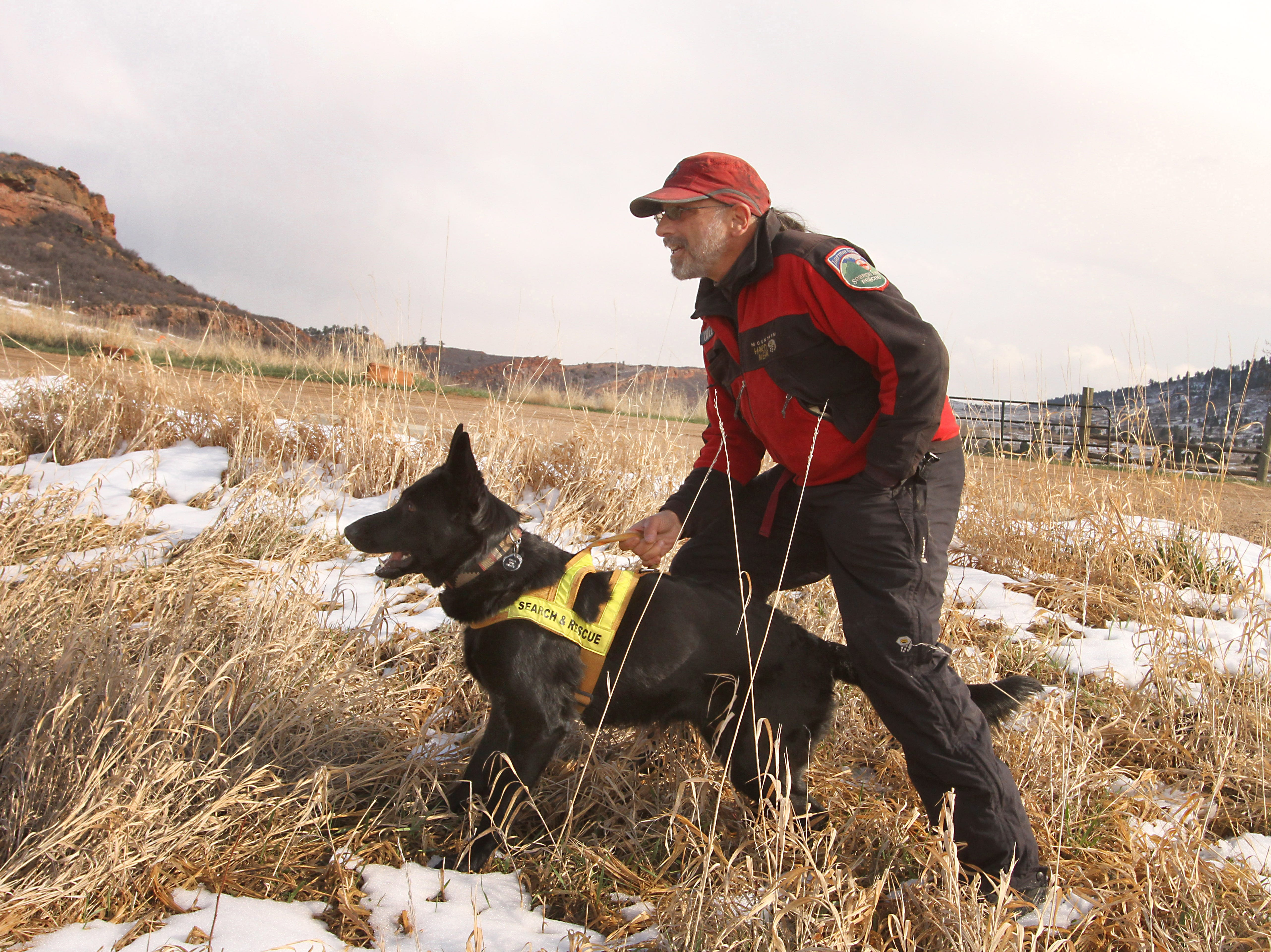 Larimer County Search and Rescue team member, Jake Udel, prepares his dog, Java, for a runaway drill during a training event held at Lory State Park on Saturday, April 13, 2019.