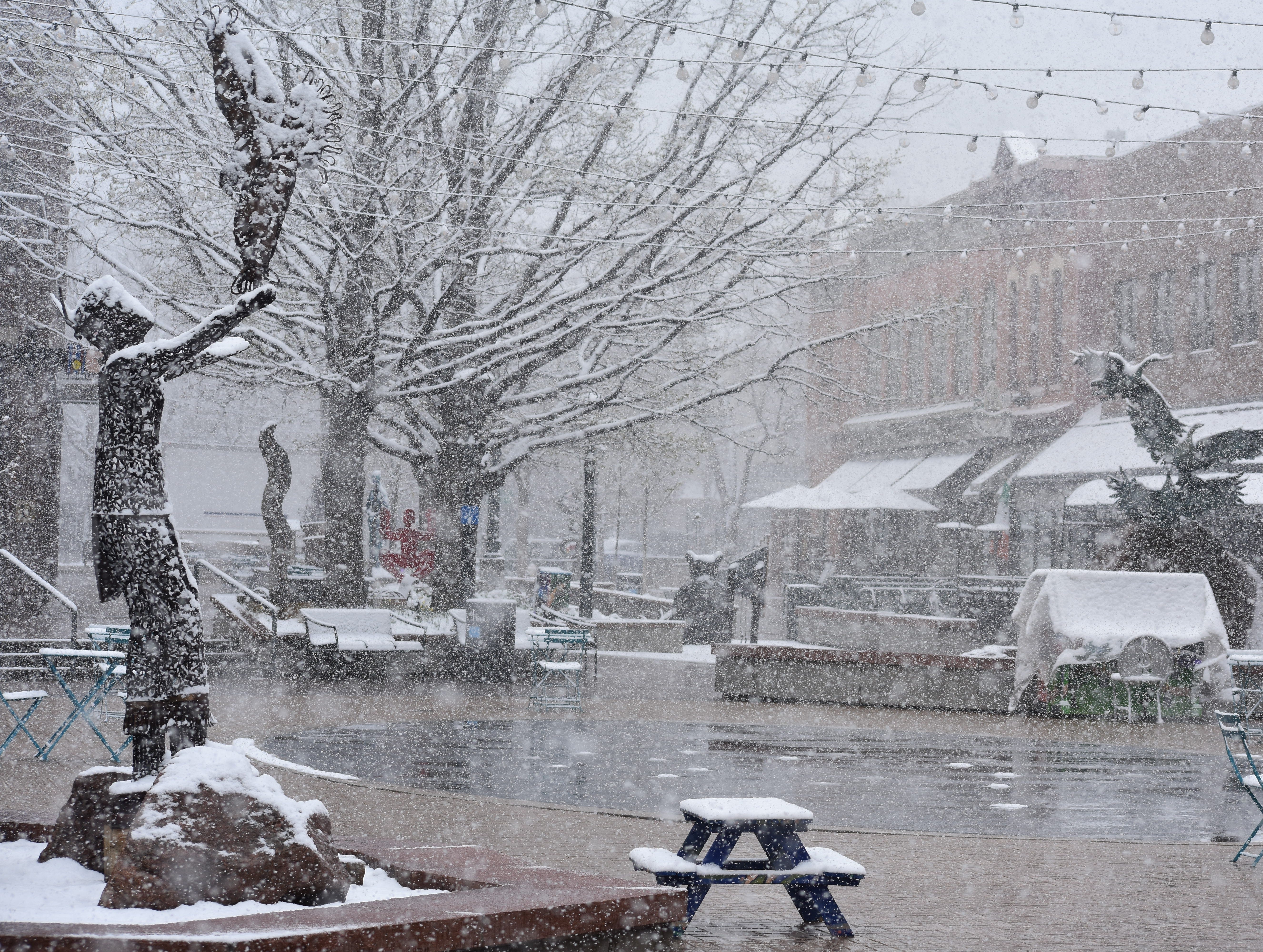 Old Town Square during Monday's snowstorm in Fort Collins.