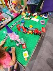 """Saturday's event will feature a variety of activities, including a """"My Own Creation"""" contest for all ages, a DUPLO play area for children ages two to five, a vehicle build and race event, collectible minifigure trading, and lots of creative play."""