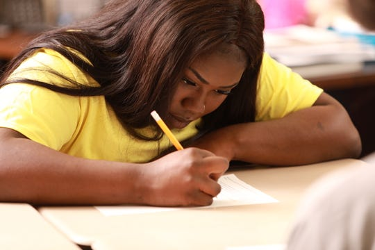 A Pace Center girl works at her desk. Pace Center for Girls harnesses the potential of each girl with a focus on their future.