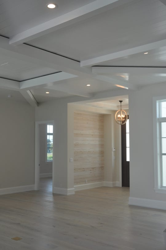 The BCB home in Hill Tide Estates is unfurnished. The great room has white nickelboard ceilings.