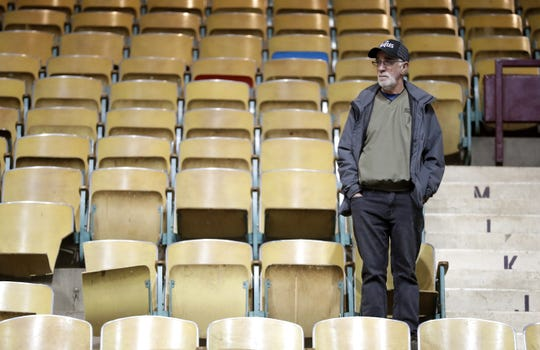 Green Bay resident Tom Thomas looks around the Brown County Veterans Memorial Arena one last time during a farewell ceremony Monday for the soon-to-be demolished building in Ashwaubenon.