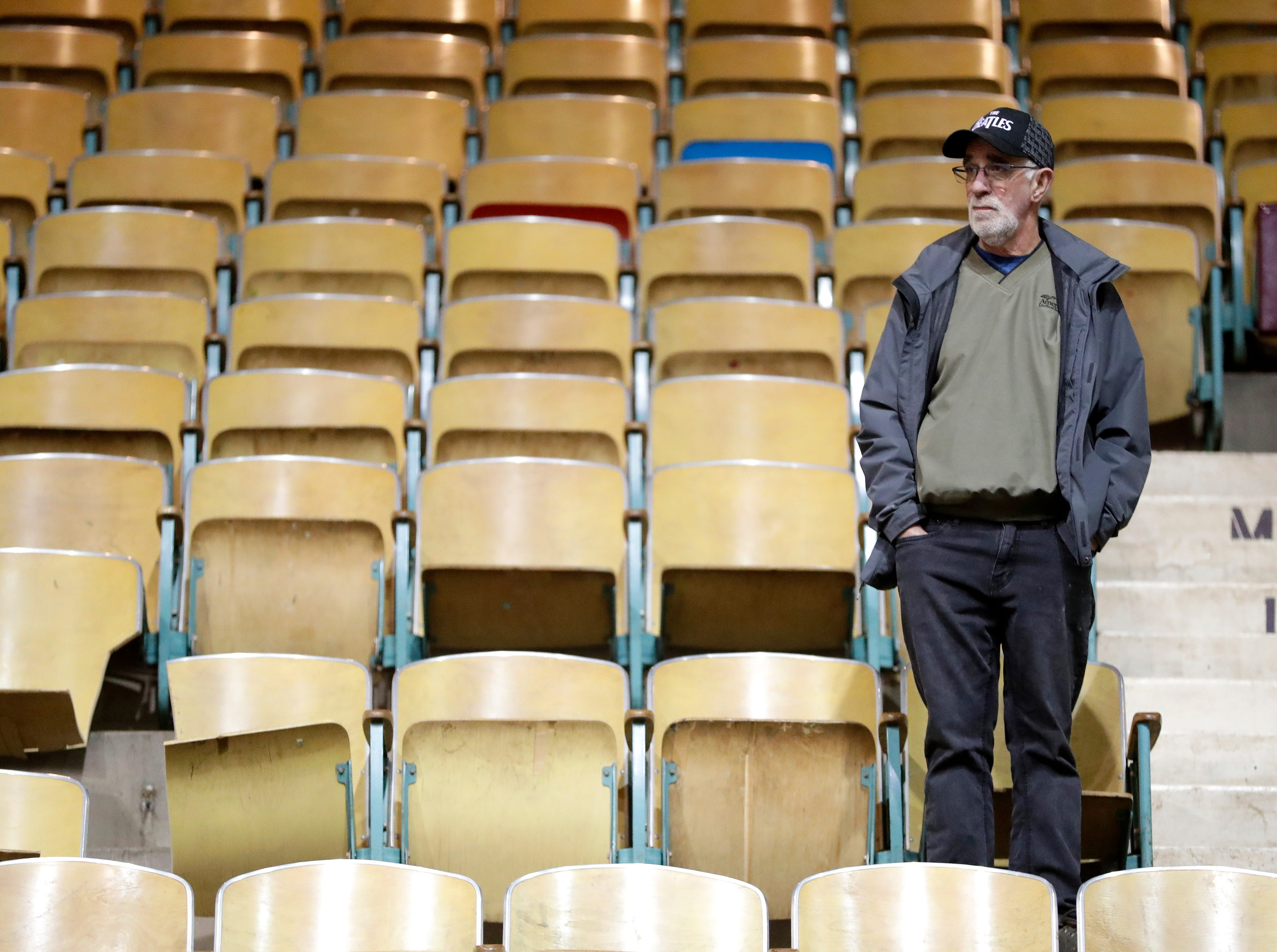 Green Bay resident Tom Thomas looks around the Brown County Veterans Memorial Arena from the seating area one last time during a farewell ceremony on April 29, 2019 for the soon-to-be demolished building in Ashwaubenon, Wis.