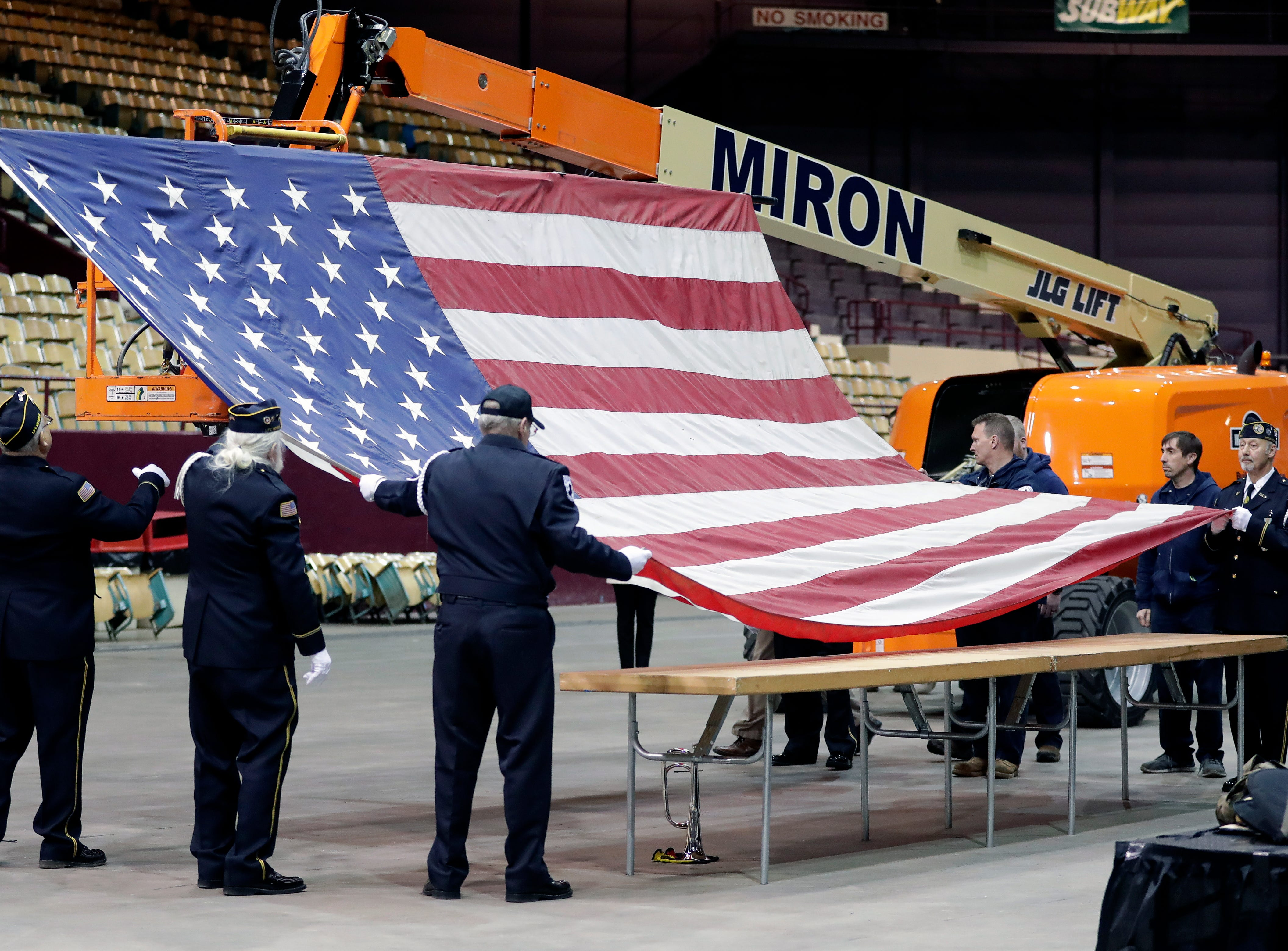 The Brown County Veterans Memorial Arena's American flag is retired April 29, 2019, during a farewell ceremony before the building is demolished.