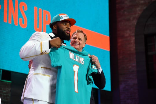 Apr 25, 2019; Nashville, TN, USA; Christian Wilkins (Clemson) celebrates with NFL commissioner Roger Goodell after he was selected as the number thirteen overall pick to the Miami Dolphins  in the first round of the 2019 NFL Draft in Downtown Nashville. Mandatory Credit: Christopher Hanewinckel-USA TODAY Sports