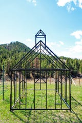 The scale model sits on the site of the original church known as the only church built in middle of the Bear Paw Mountains.