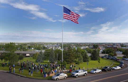 A crowd celebrates Flag Day ceremonies Friday at Broadwater Overlook Park.