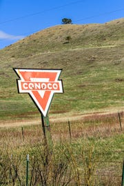 This rustic Conoco sign stands on the side of the road as you enter the town of Lloyd, MT.