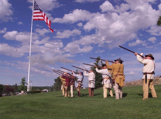 Members of the Lewis and Clark Honor Guard fire a flintlock volley to officially open the Lewis and Clark Festival weekend at Broadwater Overlook Thursday, June 22, 2000. Honor Guard members are, from left, Larry Love, Phil Scriver, Mac McDonald, Norman Anderson, Mike Staigmiller, Dugan Coburn, Charlie Brown and Walt Walker.