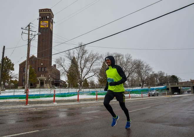 Cesar Mireles runs in the Ice Breaker Road Race 3-mile run, Sunday afternoon in downtown Great Falls.