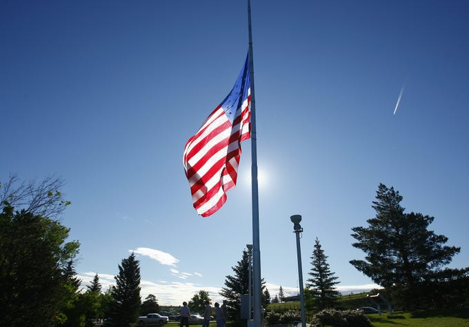 The U.S. Flag is raised during Flag Day ceremonies at Overlook Park Thursday morning.