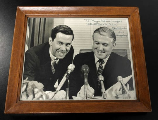 Richard Lugar kept this signed, framed photo of then-Gov. Edgar Whitcomb signing Unigov legislation on March 13, 1969 in his office.