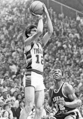 Steve Alford takes a shot in New Castle's 1983 semistate matchup at Hinkle Fieldhouse. Alford piled up 57 points and broke seven scoring records in leading his team to a 79-64 win. Alford hit 16 of 27 field goals and 25 consecutive free throws in the matchup. New Castle lost the semistate  game to the eventual state champs Connersville that evening 70-57, despite Alford's 37 points.