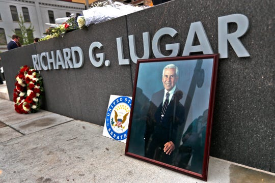 A portrait of Richard Lugar and flowers lay on the wall marking the Richard G. Lugar Plaza, at the end of a remembrance ceremony for Senator Lugar, Monday, April 29, 2019.  The ceremony honoring the life and legacy of Lugar, who died Sunday, April 28, 2019, was held at the recently-dedicated plaza.  Lane Ralph, not pictured, brought to the service this enlarged photo which was in the Senator's Indianapolis office until the day Lugar left public service in 2013.  Ralph knew Lugar and worked with him for 35 years.