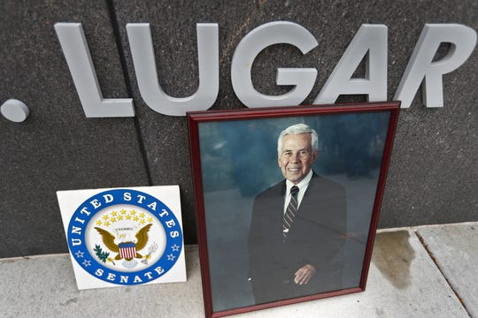 A portrait of Richard Lugar and flowers lay on the wall marking the Richard G. Lugar Plaza, at the end of a remembrance ceremony for Senator Lugar, Monday, April 29, 2019.  The ceremony honoring the life and legacy of Lugar, who died Sunday, April 28, 2019, was held at the recently-dedicated plaza.