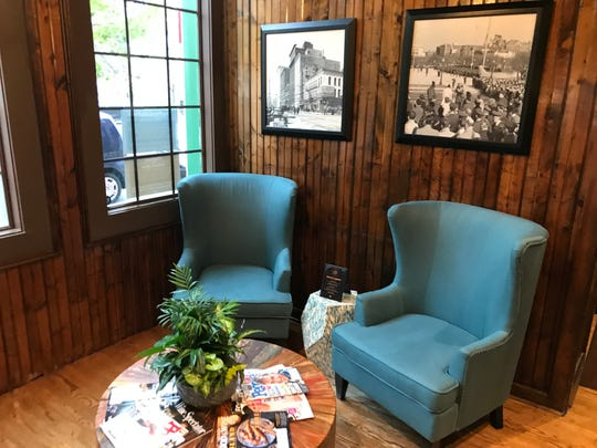 Hunker down with coffee and a magazine in cozy blue wing chairs at The Point on Penn, a new restaurant that at the former Elbow Room in downtown  Indianapolis.