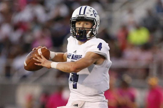 FILE -- Ben David quarter-back Trent Gipson looks to throw the ball in the first half of the game against Ben Davis at Warren Central High School in Indianapolis, Ind., Friday, Sept. 7, 2018. Warren Central defeated Ben Davis 70-27.