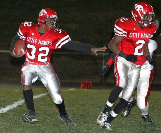 This Nov. 5, 2010 file shows City High tailback Isaiah Washpun, left, during a Class 4A quarterfinal game against Cedar Falls at Bates Field in Iowa City. Washpun died Friday, April 26, 2019.