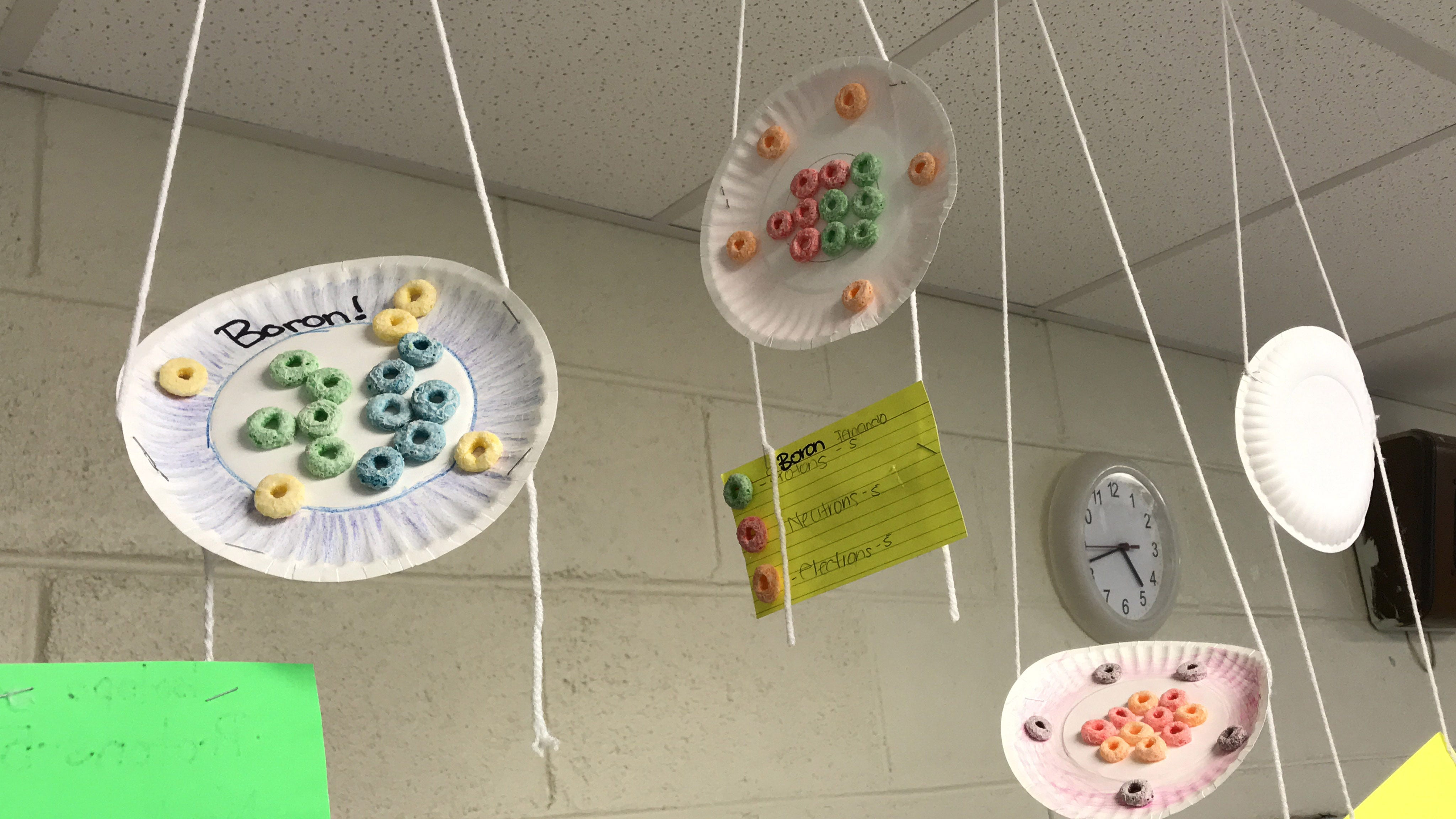 AP Chemistry student illustrations of Boron, a chemical element, hang in a classroom at Holmes County Central High School. Tuesday, April 9, 2019.