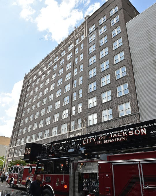 A fire broke out in the Electric building at 308 Pearl St. in downtown Jackson Monday, April 29, 2019. Sprinkler water could be seen spilling out from a ninth-floor window while observers stood and watched from the safety of Pearl and West street sidewalks.