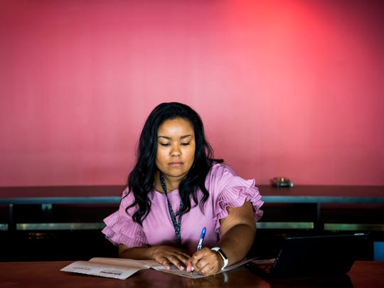 Alexus Brown, an inspector for the Department of Health, fills out permit forms for Ruby Sunshine's soon-to-open restaurant in Knoxville's Market Square on Monday, April 29, 2019.